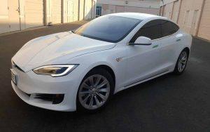 Auto Tint installation Service on this Tesla by Premier Auto Tint.
