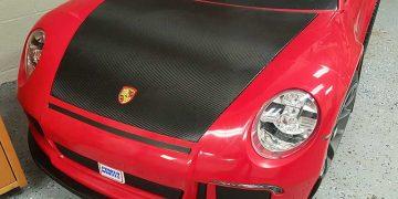 Custom Graphic Wrap Design on a Red Porsche Power Wheels by Premier Auto Tint in El Dorado Hills, CA 95762.