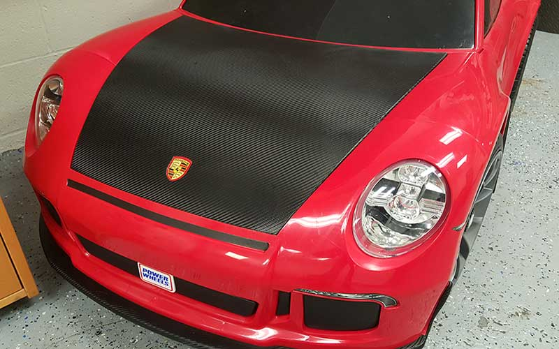 Custom Graphic Wrap Design on a Red Porsche Power Wheels by Premier Auto Tint in El Dorado Hills, CA 95762.